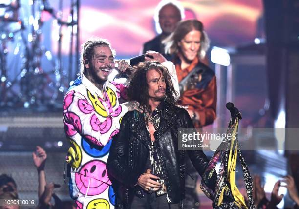 Post Malone and Steven Tyler perform onstage during the 2018 MTV Video Music Awards at Radio City Music Hall on August 20, 2018 in New York City.
