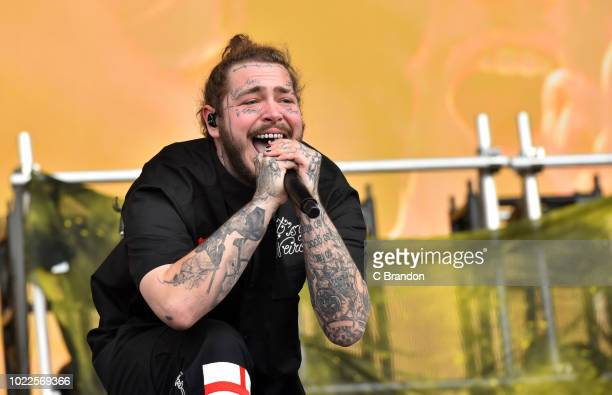 Post Malone performs on stage during Day 1 of the Reading Festival at Richfield Avenue on August 24, 2018 in Reading, England.
