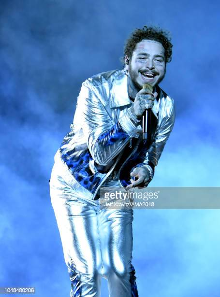 Post Malone performs onstage during the 2018 American Music Awards at Microsoft Theater on October 9 2018 in Los Angeles California
