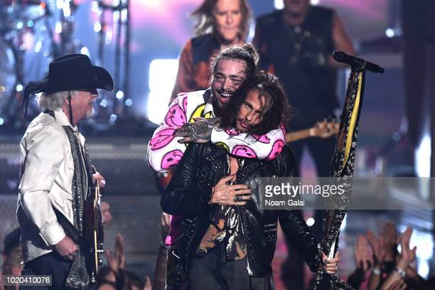 Post Malone performs with Aerosmith onstage during the 2018 MTV Video Music Awards at Radio City Music Hall on August 20, 2018 in New York City.
