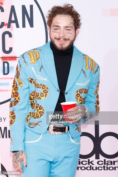 Post Malone photographed on the red carpet of the 2018 American Music Awards at the Microsoft Theater on October 9 2018 in Los Angeles USA