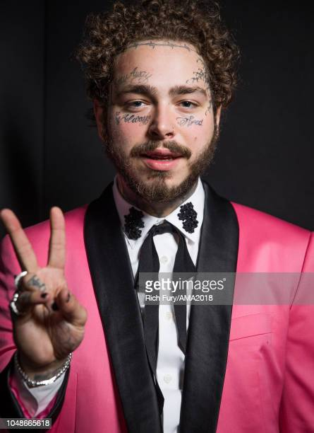 Post Malone poses for a portrait at the American Music Awards at Microsoft Theater on October 9 2018 in Los Angeles California