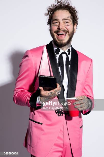 Post Malone poses for a portrait at the American Music Awards at Microsoft Theater on October 9, 2018 in Los Angeles, California.