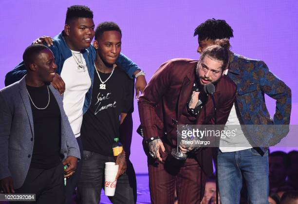 Post Malone recipient of the award for Song of the Year and 21 Savage speak onstage during the 2018 MTV Video Music Awards at Radio City Music Hall...