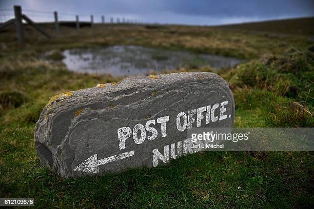 Post mistress Sheila Gear working in the Island of Foula Post Office on September 30 2016 in Foula Scotland Foula is the remotest inhabited island in...