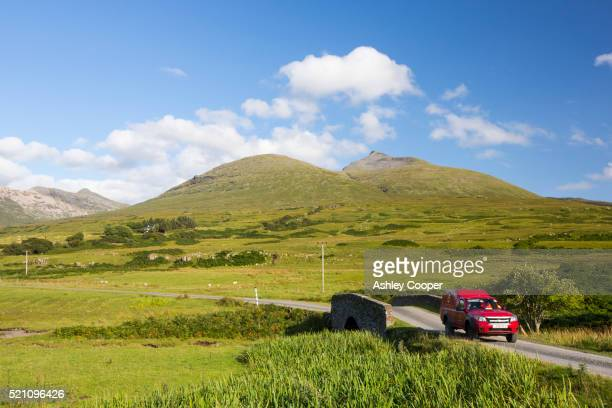 A post office car on the road below Ben More, a Munro on the Isle of Mull, Scotland, UK.