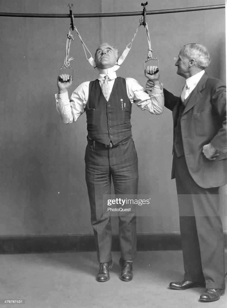 Demonstration Of Neck-Stretching Device : News Photo