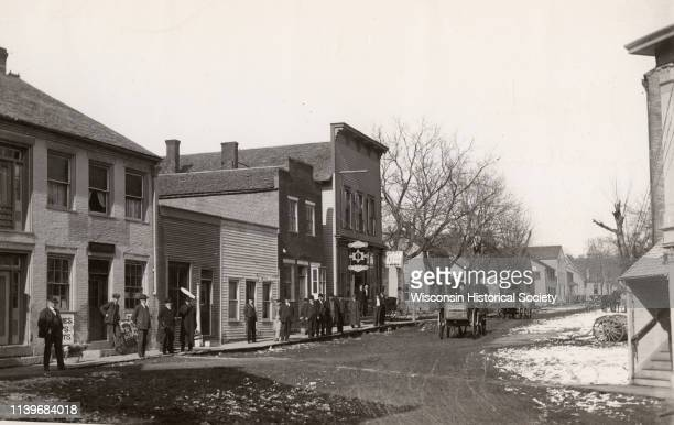 Post office is first building on the left, Potosi, Wisconsin, 1906. Other buildings occupied by doctor's office, saloon, livery and feed stable, etc....