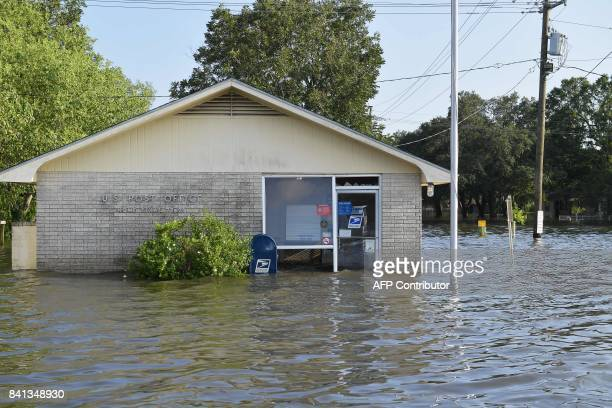 A post office is seen in floodwaters in Nome Texas some 20 miles from Beaumont Texas on August 31 2017 Residents of the US Gulf Coast states of Texas...