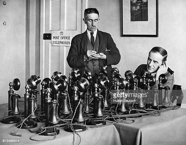 Post Office officials testing out a batch of new telephones ready for installation at Wembley Stadium to distribute the news of the forthcoming Cup...