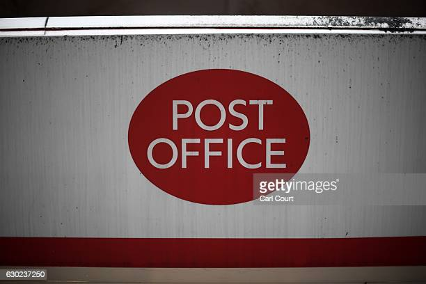 Post Office sign is displayed outside a branch on December 19 2016 in London England A strike at Crown post offices has closed around 50 of the 300...
