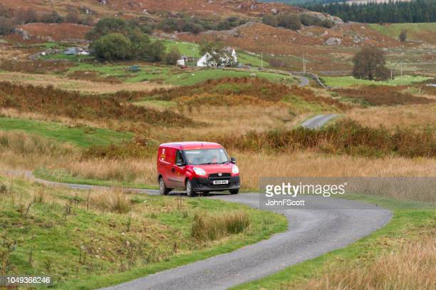 Post van on a rural road in Dumfries and Galloway south west Scotland
