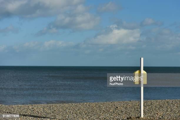 A post with lifebuoy near the sea front promenade in Bray On Thursday February 15 Dublin Ireland