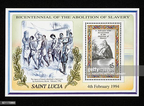 Postage and sheet commemorating the Bicentenary of the abolition of slavery depicting chained slaves and view of the island Saint Lucia 20th century...