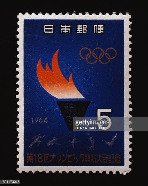 Postage stamp commemorating the Tokyo Olympics depicting the Olympic flame Japan 20th century Japan