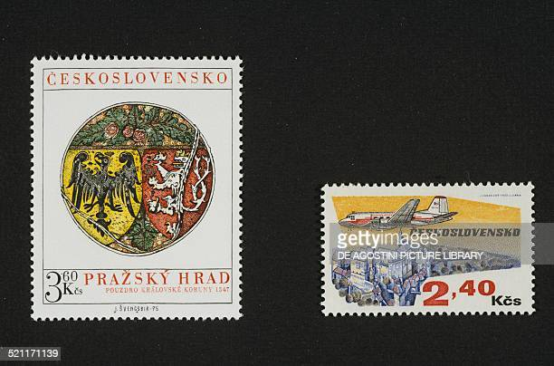 Postage stamp depicting a coat of arms from 1347 and on the right postage stamp depicting an aircraft flying over a castle 1973 Czechoslovakia 20th...