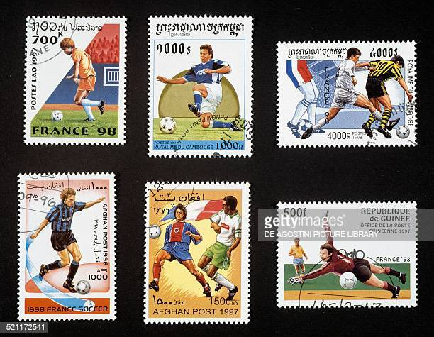 Postage stamps commemorating the 1998 FIFA World Cup in France depicting scenes of play Laos Cambodia Afghanistan Republic of Guinea 1997 20th...