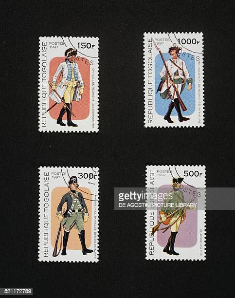 Postage stamps from the Old military uniforms series depicting from left to right and from top to bottom Cuirassier officer Infantry musketeer...