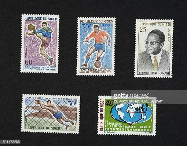 Postage stamps from the series commemorating the 1966 FIFA World Cup in England depicting players and goalkeeper in action top right postage stamp...