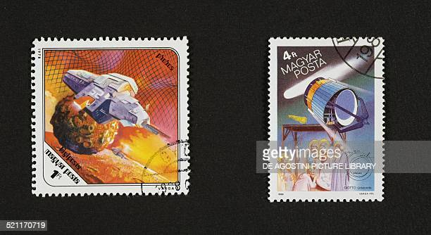Postage stamps honouring Space research on the left Spaceship flying over Phobos a satellite of Mars on the right the passage of Halley's comet the...