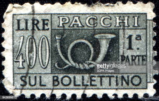 CIRCA 1946 A postage stamps printed in Italy for packets and parcels shows post horn
