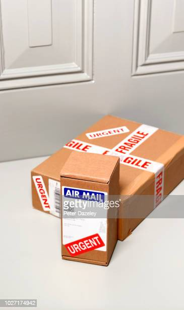 postal deliveries left on doorstep - fragile sign stock pictures, royalty-free photos & images