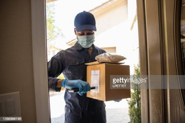 postal delivery service - essential workers stock pictures, royalty-free photos & images