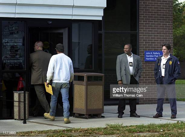 Postal Inspectors stand watch outside the main post office for Trenton NJ October 16 in Hamilton NJ The letters containing anthrax that were mailed...