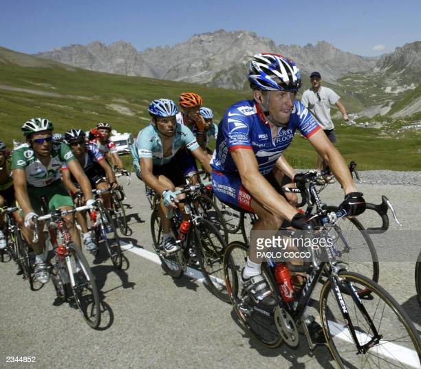 US Postal leader Lance Armstrong rides in front of German Jan Ullrich and Frenchman Christophe Moreau during the eighth stage of the 90th Tour de...