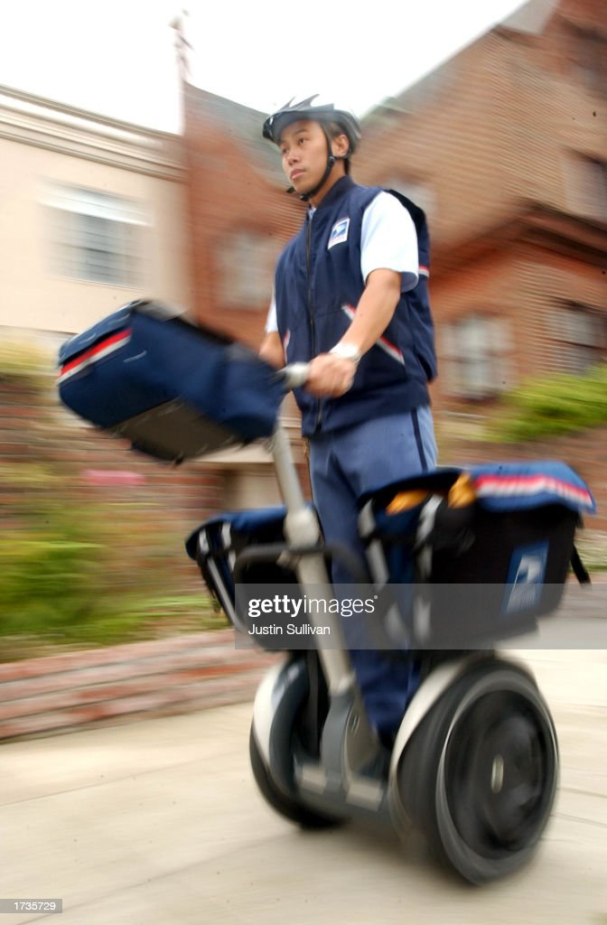 U.S. Postal lettercarrier K. Ng rides a Segway Human Transporter on his postal route July 15, 2002 in San Francisco, California. San Francisco became the first municipality in the U.S. to ban the personal vehicles from city sidewalks. California has passed legislation permiting sidewalk use of the two-wheeled carrier, which can reach 12.5 mph, but permits cities to opt out.