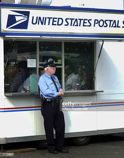 A postal security officer stands guard October 23 2001 outside the temporary post office set up outside the Hamilton NJ Post Office which is the main...