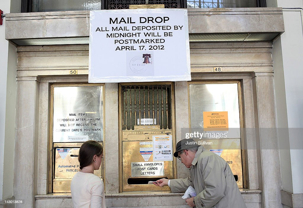 S Postal Service Customers Drop Letters Into A Mail Slot At The James A  Farley Post