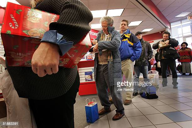 S Postal Service customers wait in line to mail Christmas presents at a US Post Office December 20 2004 in Washington DC The Monday before Christmas...