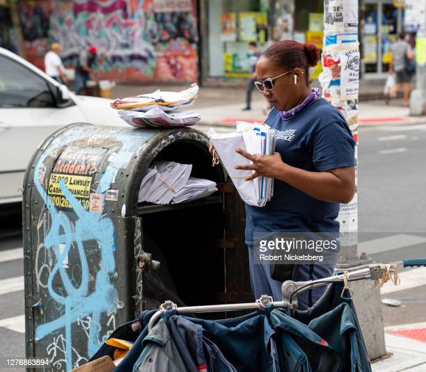 Postal Service employee sorts mail at a distribution box September 26, 2020 in New York City. For the U.S. Presidential election on November 3 voter...