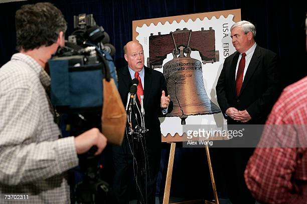 S Postal Service Governors Board Chairman Jim Miller and US Postmaster General Jack Potter talk at a news conference introducing the Forever Stamp at...
