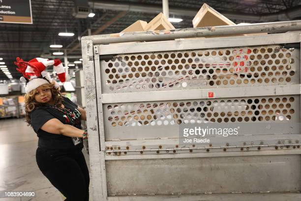 S Postal service mail handler Joycelyn Brown prepares a box full of packages for sorting at the US Postal service's Royal Palm Processing and...