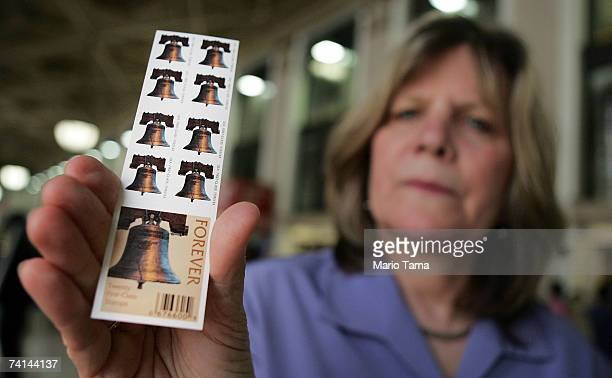 S Postal Service spokeswoman Pat McGovern displays the Postal Service's new forever stamp booklet inside the James A Farley post office building May...