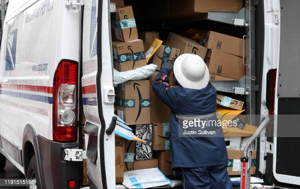 Postal Service worker unpacks packages from a truck on December 02, 2019 in San Francisco, California. Cyber Monday shoppers are on track to spend a...