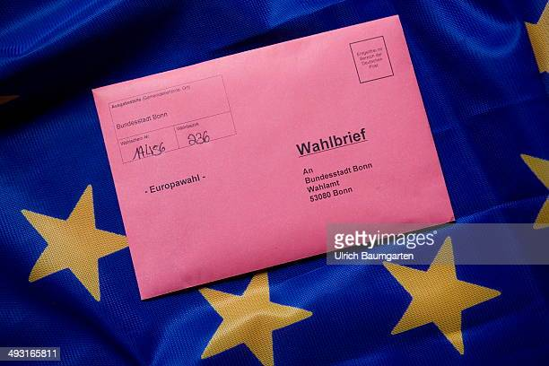 Postal vote envelope to the 2014 European elections on a European flag on May 22 2014 in Bonn Germany