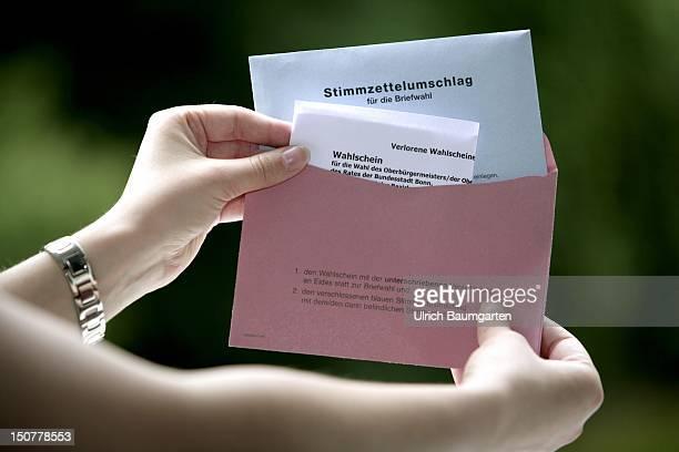 GERMANY BONN postal vote Hands hold a letter with postal vote forms
