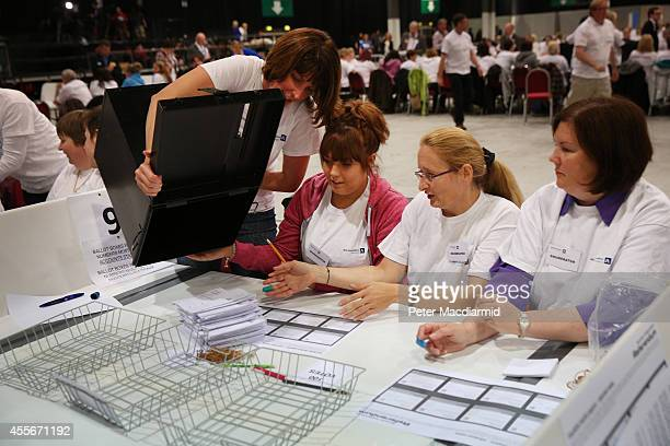 Postal votes are delivered to enumerators at the count centre for the Scottish referendum on September 18 2014 in Aberdeen Scotland Polls have now...