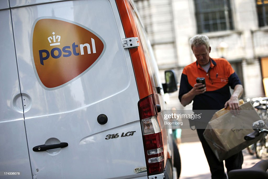A postal worker for PostNL NV delivers post in Amsterdam, Netherlands, on Tuesday, July 23, 2013. Dutch pension funds will be allowed to calculate liabilities on the basis of an adjusted discount rate as the government seeks to keep the retirement system viable amid low interest rates and an aging population. Photographer: Matthew Lloyd/Bloomberg via Getty Images