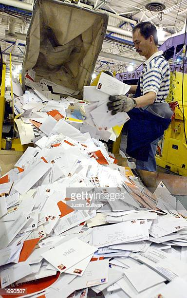 S Postal worker George Lacap sorts mail at the San Francisco Processing and Distribution Center December 16 2002 in San Francisco California On the...