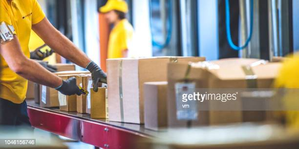postal worker handling packages - work glove stock pictures, royalty-free photos & images