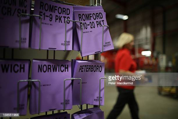 A postal worker passes a rack of destination cards at Royal Mail's Medway Sorting Centre on December 18 2012 in Rochester England The recently opened...