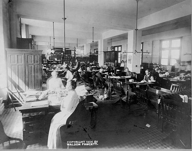 Postal Workers in Dead Letter Office Pictures | Getty Images