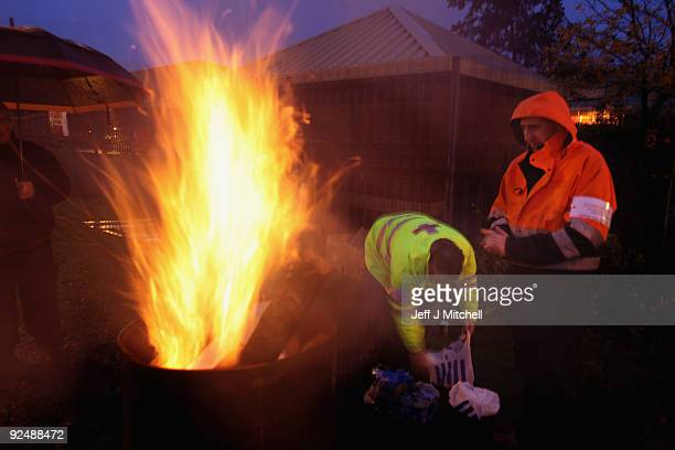 Postal workers stand beside a brazier on the picket line at Glasgow mail centre on October 29 2009 in Glasgow Scotland Mail centre staff and drivers...