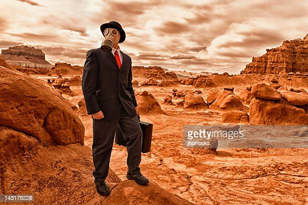 post-apocalyptic businessman - climate stock pictures, royalty-free photos & images