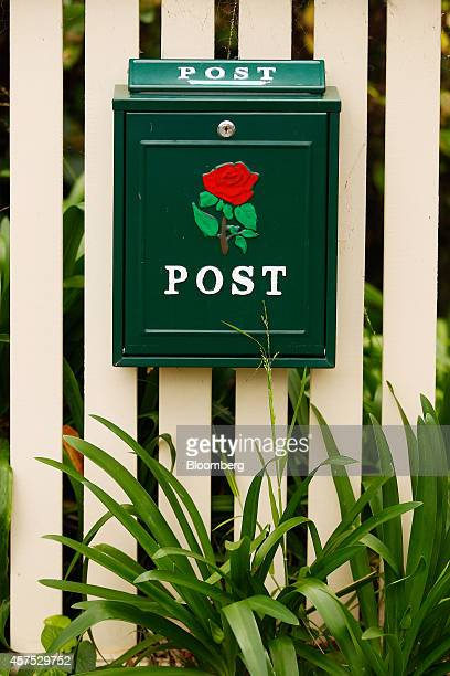A postbox sits on the fence of a house in the suburb of Roseville in Sydney Australia on Saturday Oct 18 2014 Sydneys median home price rose 14...