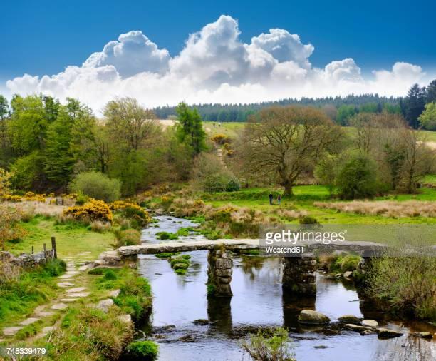 uk, postbridge, clapper bridge over east dart river at dartmoor national park - devon stock pictures, royalty-free photos & images